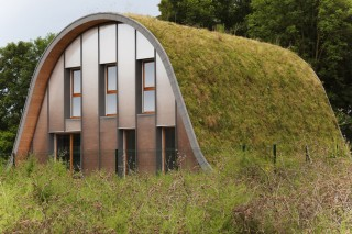 Округлый домик с «зеленой» термоизоляцией